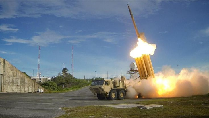 The first of two Terminal High Altitude Area Defense (THAAD) interceptors is launched during a successful intercept test. The test, conducted by Missile Defense Agency (MDA), Ballistic Missile Defense System (BMDS) Operational Test Agency, Joint Functional Component Command for Integrated Missile Defense, and U.S. Pacific Command....