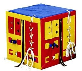 "The Developmental Play Cube is a great tool to develop manual dexterity and dressing skills. The four-sided solid foam cube is 17"" high and covered with vinyl. The hardware is industrial strength so it will stand up to heavy use. Great for play rooms, day care facilities, occupational therapy clinics, physical therapy clinics and waiting rooms. This fine motor laboratory has zippers, laces, buttons, bow ties, Velcro, and chrome closures."
