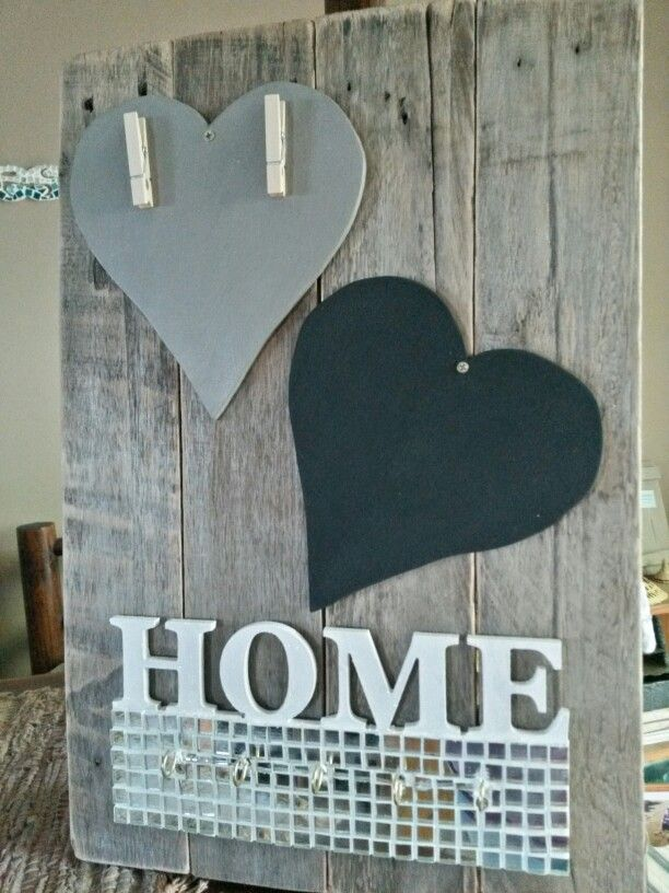 Pallet board with key hooks, chalkboard and memo or photo board