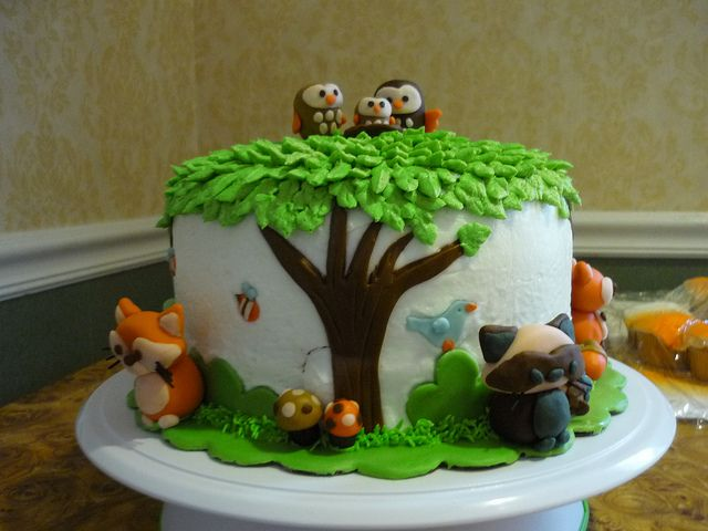 Woodland creatures cake, so cute! Love the little owls on top :)
