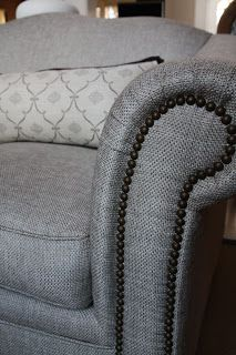 Sectional Sofa adding New life to a dated piece of furniture Updated fabric nailheads are details that make the difference