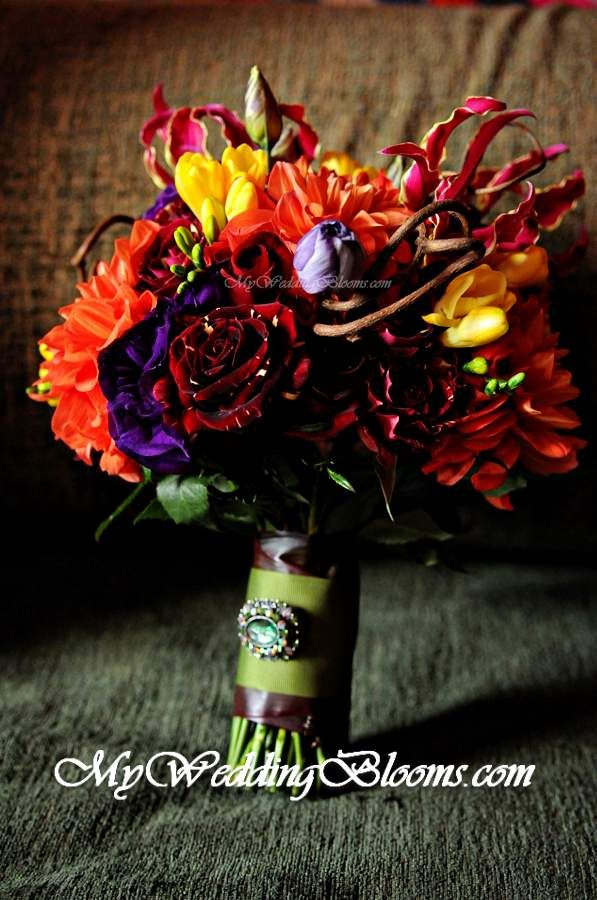 Take out the gloriosa lilies and add some berries to create a more vineyard feel.  Photo & Design Credit...MyWeddingBlooms.com