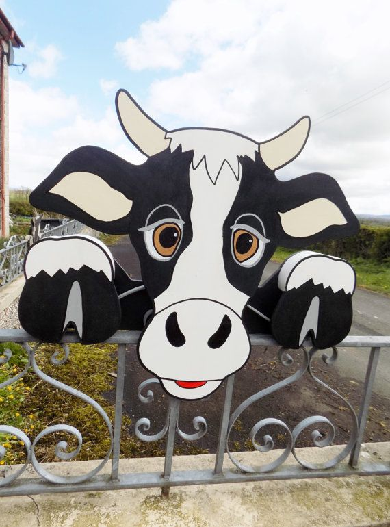 Cow Fence Sitter.  Handmade and hand painted.  Can be used indoors and outdoors.  A unique gift for any animal lover.