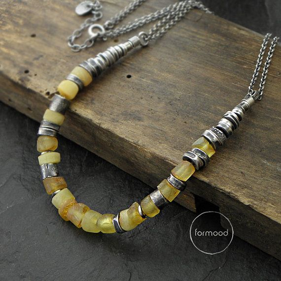 Necklace - raw sterling silver and Baltic amber. I love how this artist uses silver bands throughout their work.
