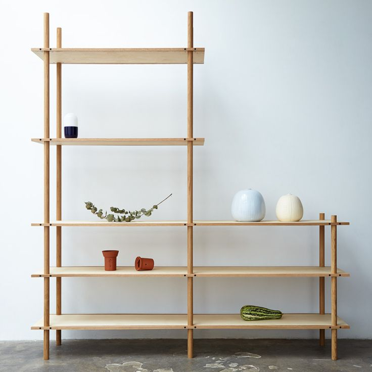 Butty is a modular shelving with solid oak dowel uprights and birch plywood shelves. The shelves are sandwiched by oak strips and clamped to the uprights to make them adjustable. The tall units can be used as a space divider.