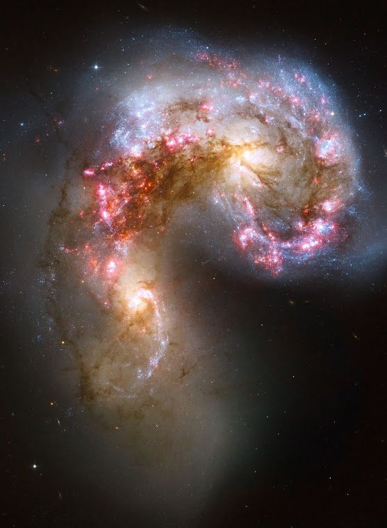This new NASA Hubble Space Telescope image of the Antennae galaxies is the sharpest yet of this merging pair of galaxies. During the course of the collision, billions of stars will be formed. The brightest and most compact of these star birth regions are called super star clusters.