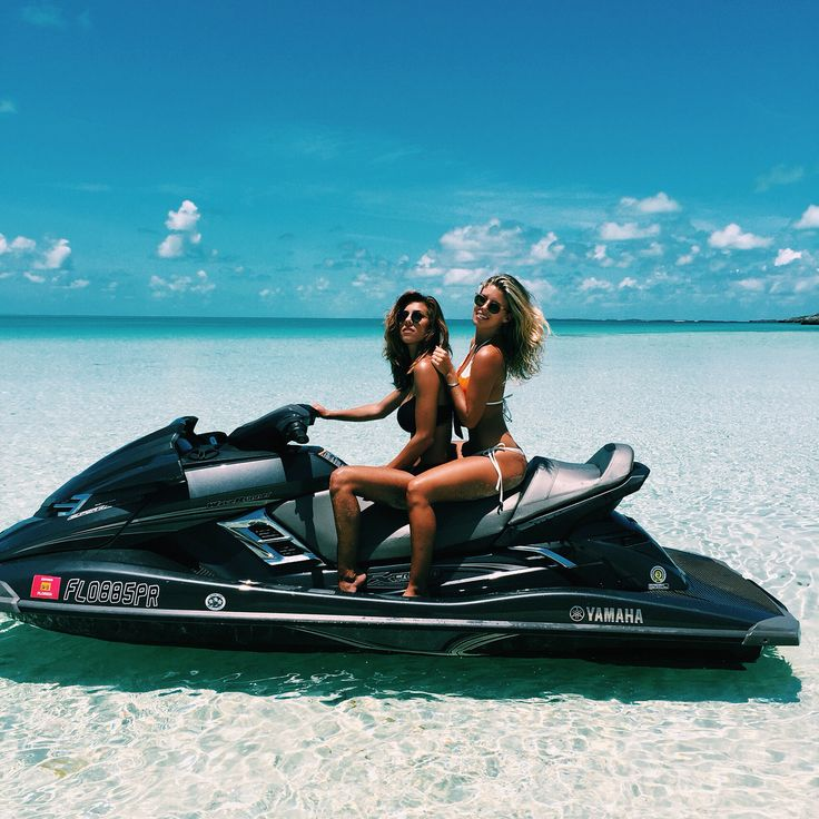 Natasha oakley and Devin Brugman on a jet ski in the Bahamas