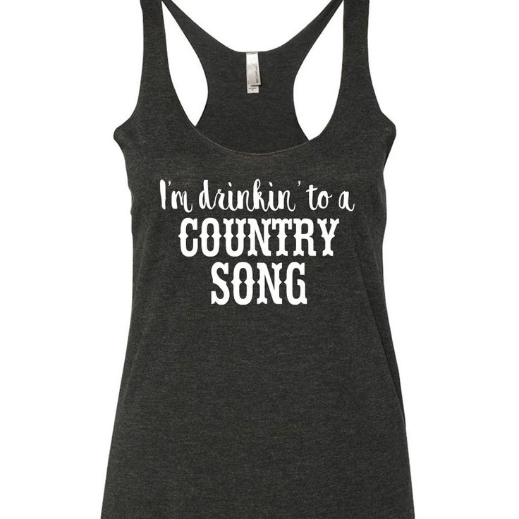 I'm drinkin to a country song printed on a triblend, racerback tank top. These tanks are a mix of cotton and poly, making them super soft and light. This is a relaxed-fit tank that runs true to size (