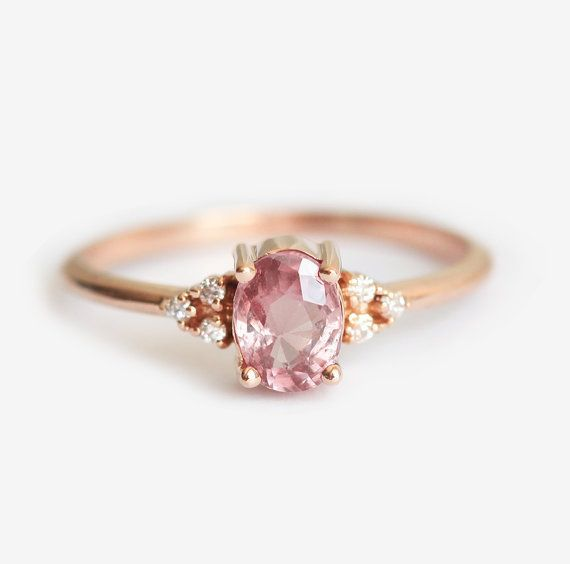 Beautiful simple peach - pink sapphire ring in 14k rose gold. Product details Gemstone: peach sapphire 0.92 carat, 6.5 x 5mm Quality: VS clarity Treatment: None. Shape: oval Diamonds: VS clarity, G color, non conflict, total carat weight 0.15 carat Material: 14k yellow/white/rose solid gold