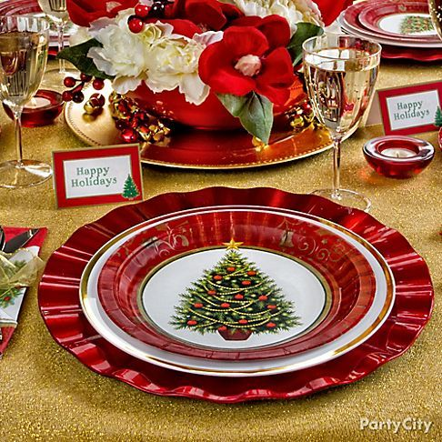 Get in the holiday spirit by decking the dining table with holiday cheer by pairing pretty chargers with holiday-themed plates and a vibrant centerpiece.