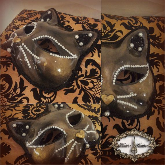 Golden and black Venetian mask, inspired by the traditional Italian Gnaga mask. Totally hand-painted. The mask is beautifully decorated with black