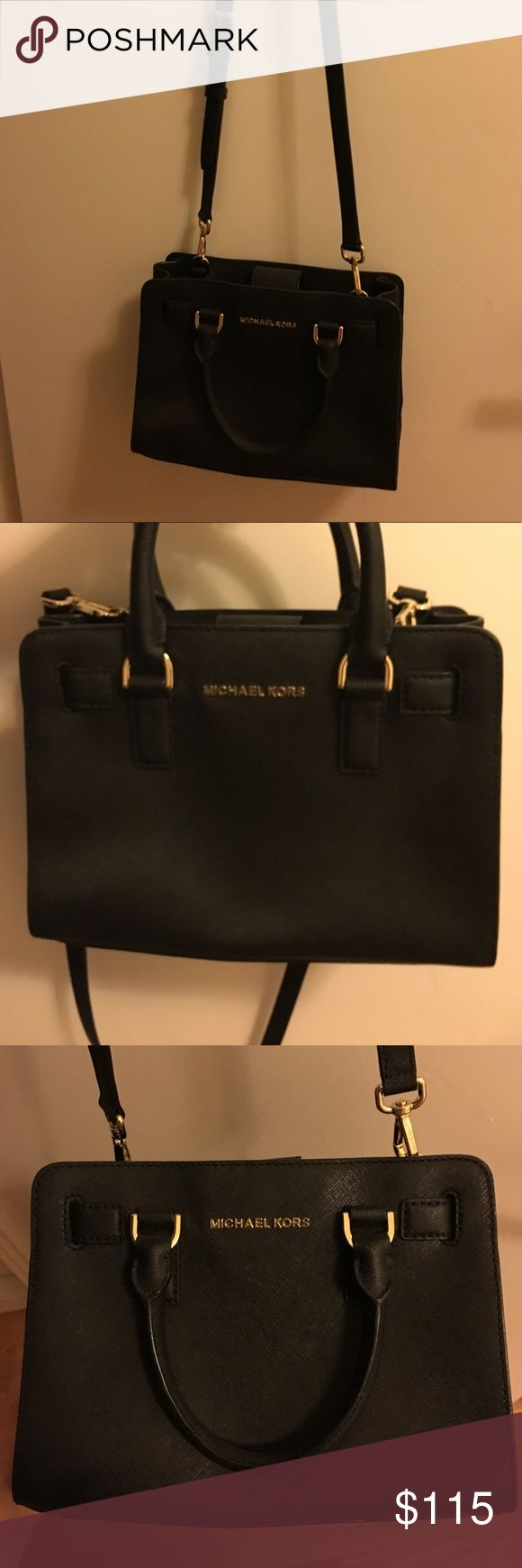Michael Kors black crossbody Medium rectangular cross-body in excellent, barely used condition. Comes with two handles and long detachable strap. Michael Kors Bags Crossbody Bags