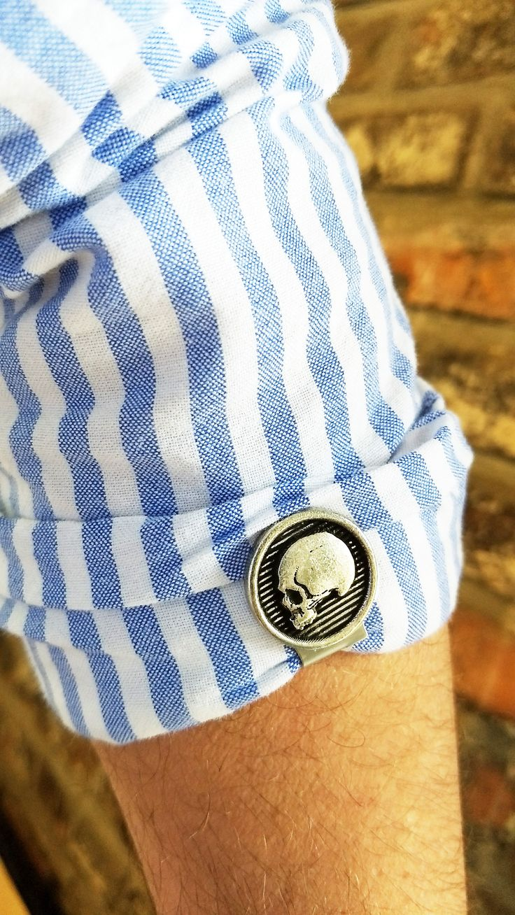 Skull Sleeve Clips.  brand new invention for rolled sleeves.  decorative locks for rolled sleeves.