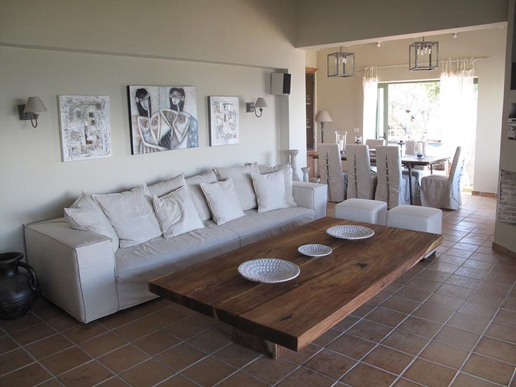 A four seat linen covered sofa in the living room and a large teak wood coffee table
