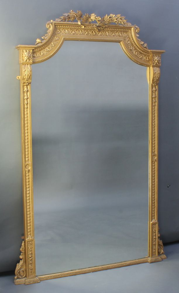 """Lot 894, A 19th Century shaped plate mirror contained in a decorative gilt frame with acanthus leaf decoration 72""""h x 44""""w est £200-300"""