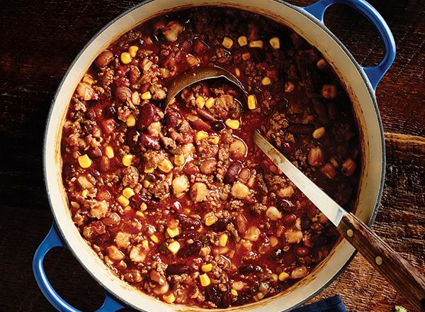 1 1/2 lb ground beef 1 packet taco seasoning mix (about 1 oz) 2 (10-oz) cans diced tomatoes with chiles, undrained 1 can chili beans in sauce (15–16 oz), undrained 1 can red kidney beans (15–16 oz), undrained 1 (15.5-oz) can hominy, drained 1 (15.25-oz) can Southwestern corn with peppers, drained 1 (10-oz) can mild enchilada sauce  Steps Preheat large, nonstick sauté pan on medium-high 2–3 minutes. Place beef in pan (wash hands); brown 5–7 minutes. Stir in taco seasoning;...crock pot