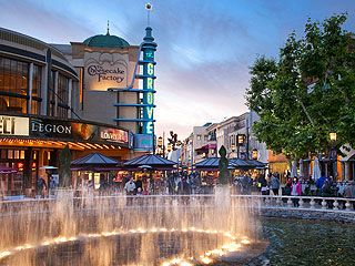 The Grove (Mid-wilshire)   Feels as festive as Disneyland but it's an outdoor shopping mall! Fountains, music, and a trolley! Always packed with people.