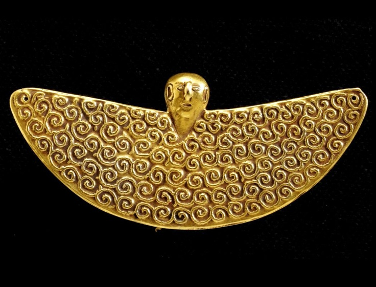 Indonesia | Winged spiral pendant (amulet) from Tanimbar Islands, Moluccas | Gold | Circa 18th - 19th century | Price on request