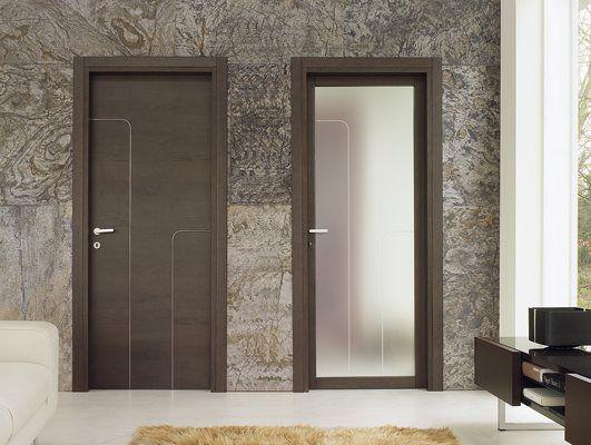 - Apri e Chiudi. Soluzioni per porte e finestre - Porta in Wenge con inserti in metallo
