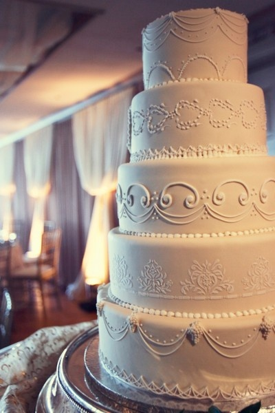 5-tier ivory wedding cake with piped royal icing details and stencil work.  Photo by Jeffery & Julia Woods via Style Me Pretty.  Cake by ??