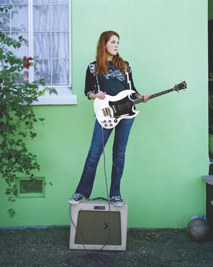 Neko Case With Here Electric Tenor Guitar Outside Her Home From A 2009 Interview By