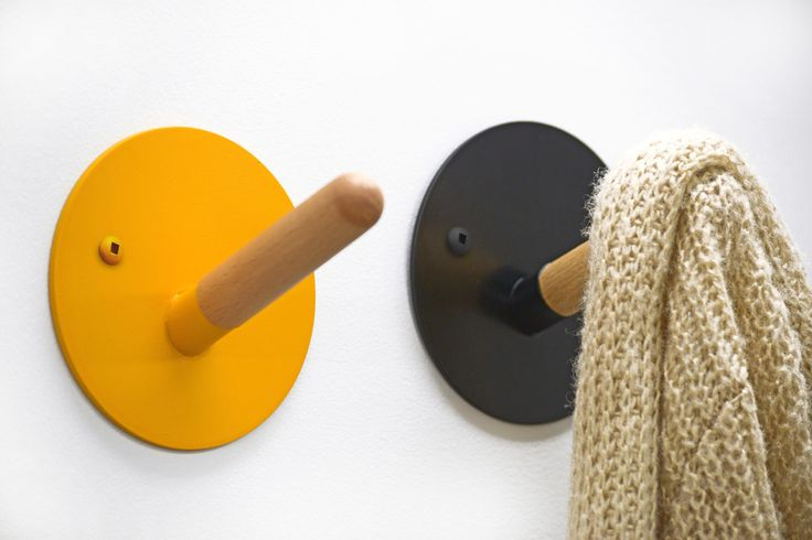 Fib coat hook by Kvell. Simple and smart, the Fib hooks tell just enough white lies to hang your coat on. Made from durable stamped steel and turned solid beech, Fib is an updated take on the traditional wall hook and comes in a range of colors suited to any home.
