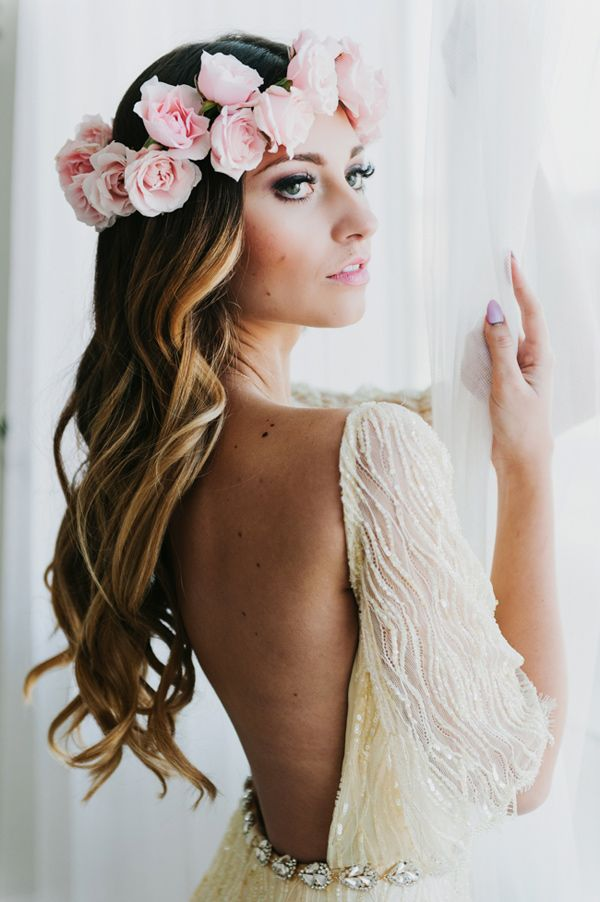 loose waves and a floral crown - photo by Lori Romney Photography http://ruffledblog.com/bohemian-valentines-day-inspiration #weddingdress #hair #flowercrown