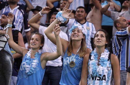 Die Fans in Rio sind im Olympia-Fieber. Mehr Fan-Bilder gibt es in unserer Fotostrecke. Foto: AP