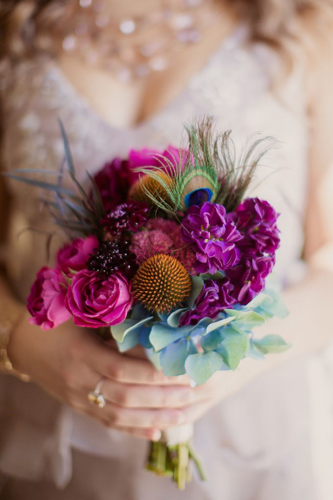 Jewel-tone bridesmaid bouquet. Love it but without the peacock feather and that orange spikey thing in the front :)