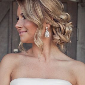 love this hair! with the loose curls and romantic messy bun!