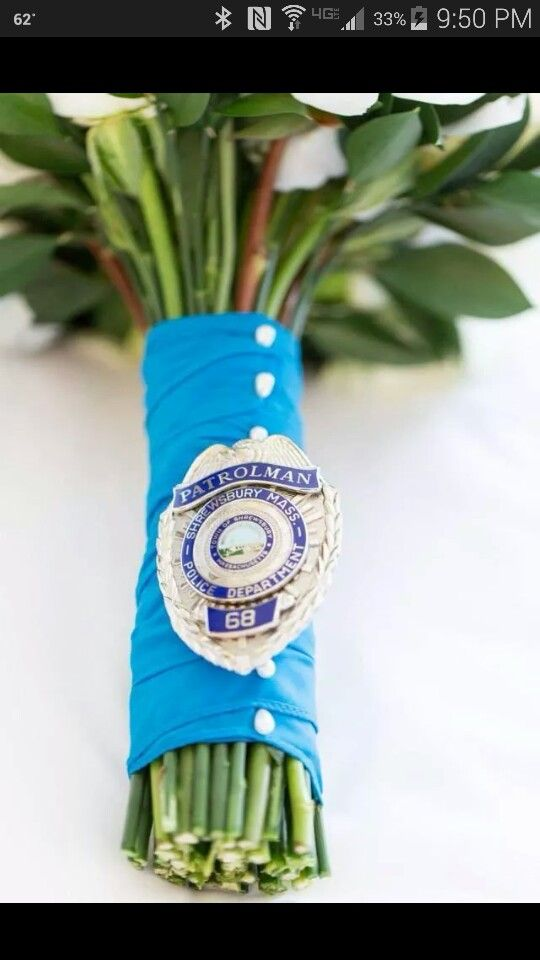 I love this, having his badge on my bouquet! #POLICEWIFE #lawenforcement wedding police, sheriff's deputy