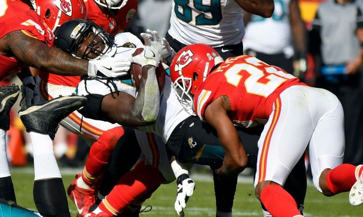 Jaguars vs. Chiefs  -  19-14, Chiefs  -  November 6, 2016  -    Jacksonville Jaguars running back Chris Ivory, center, is tackled by Kansas City Chiefs defensive back Marcus Peters (22) during the first half of an NFL football game in Kansas City, Mo., Sunday, Nov. 6, 2016.
