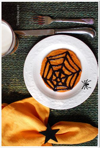 spooky pumpkin pancakes with black cinnmon syrup...Halloween breakfast or dinner!!