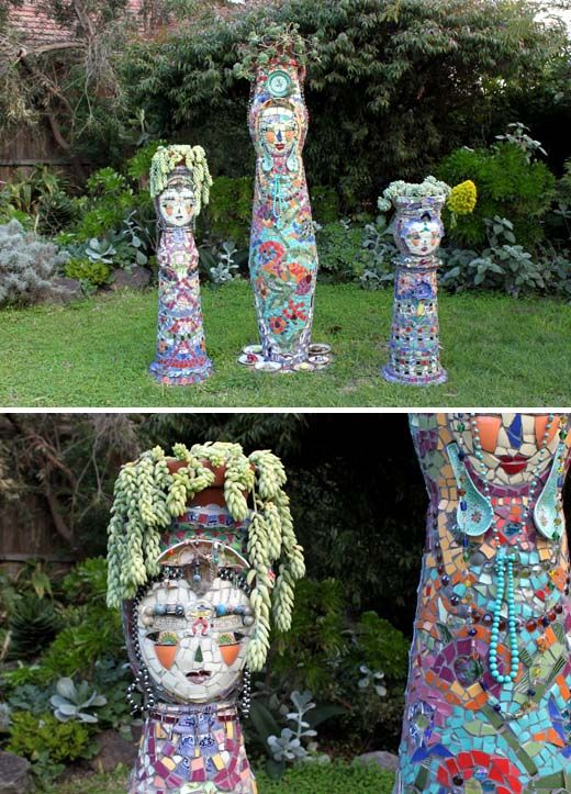 The raddest planters ever.  Homemade mosaic ladies.