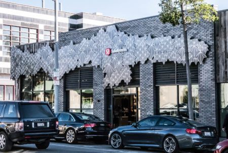 Location: West Hollywood, CA This Melrose Avenue, West Hollywood Lululemon location prominently features a Solutions Studio® custom exterior façade, designed and manufactured by Artkura, in collaboration with Lululemon. This unique shell wraps around the storefront, and incorporates both hard geometric lines and a subtle organic mountainscape silhouette. Entering the store's 2,700-square-foot Quadrangle Architectsdesigned shopping space,you'll …