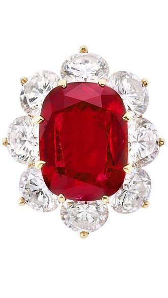 Gold, Ruby and Diamond Ring, Tiffany & Co.  18 kt., centering one cushion-shaped ruby approximately 6.50 cts., surrounded by 8 round diamonds approximately 5.20 cts., signed Tiffany & Co.