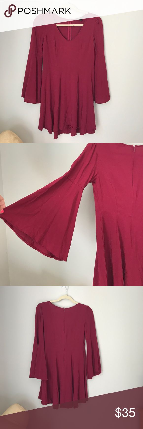 Bell sleeve skater dress Maroon color and only worn once! Thin enough for early fall and very float material! Absolutely love it but doesn't fit anymore Express Dresses Long Sleeve