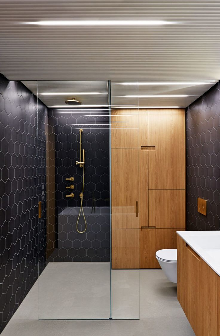 Elegant Black And Brass Bathroom Design With Wooden Touches