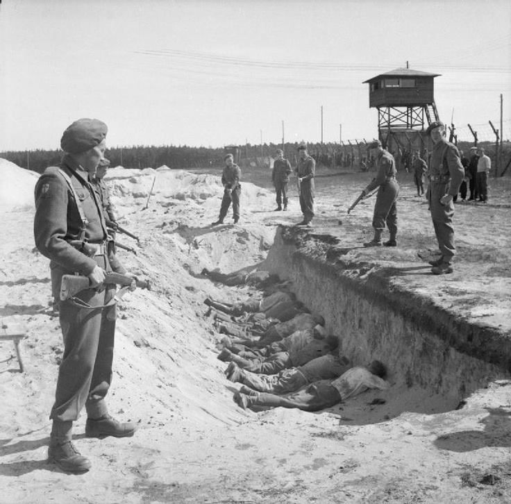 German SS guards, exhausted from their forced labor clearing the bodies of the dead, are allowed a brief rest by British soldiers but are forced to take it by lying face down in one of the empty mass graves. Bergen-Belsen April 1945. Although the Germans know they won't be shot as they lie where they do, the experience should have been educational -- the feeling of lying face down in a ditch with guns pointed at you.