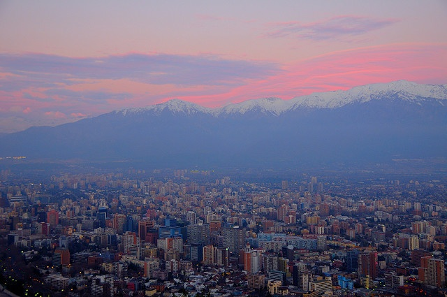 View of sunset over the Andes from San Cristobal Hill in Santiago, Chile. So amazing!