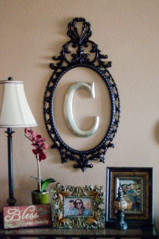 Monogram letter in frame.