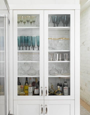 dining room bar cabinet shows off pretty stemware in all the right colors not totally necessary along with an eclectic collection of bottles while - Dining Room Cabinets Ikea
