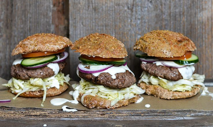 Juicy burger with creamy feta cheese sauce and pickled cabbage