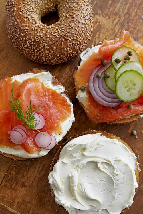 Bagels with Cream Cheese, Lox (smoked salmon), and an assortment of accoutrements.. like capers, onion, radishes and cucumber. One of my favorite things in the world, especially on Sundays.