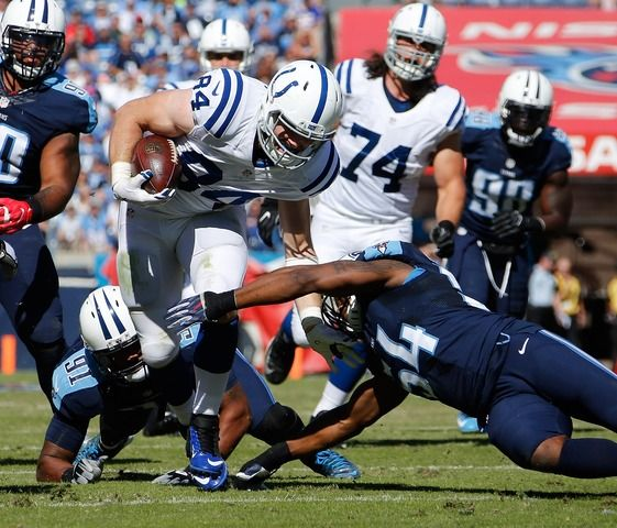 Colts vs. Titans  -  26-34, Colts:  October 23, 2016  -      NASHVILLE, TN - OCTOBER 23: Jack Doyle #84 of the Indianapolis Colts is tackled by Derrick Morgan #91 and Avery Williamson #54 of the Tennessee Titans during the first half at Nissan Stadium on October 23, 2016 in Nashville, Tennessee. (Photo by Frederick Breedon/Getty Images)
