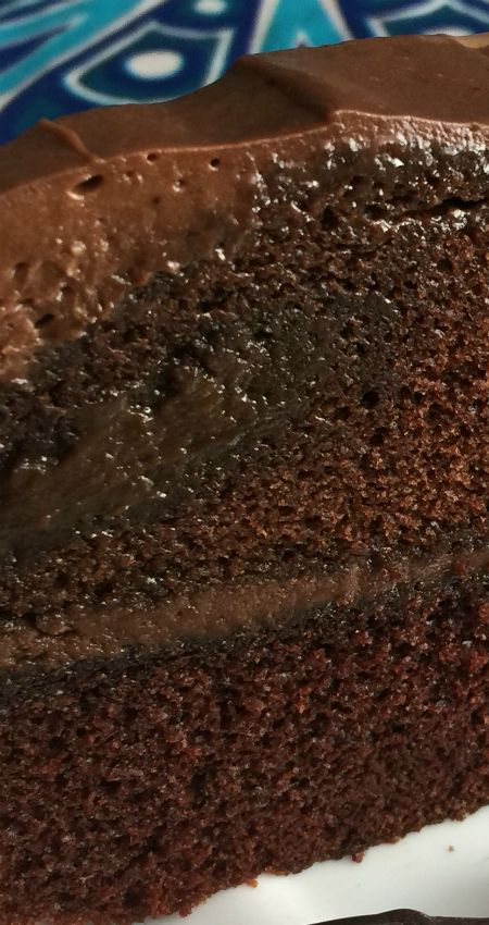 Moist Chocolate Cake ~ This dense and super-moist chocolate cake recipe is made all the better with a generous layer of chocolate cream cheese frosting
