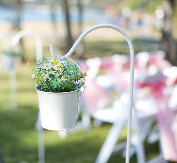 Beach Wedding / Ceremony set-up by Waterside Events, Currumbin RSL team on the Gold Coast. Some gorgeous hanging bucket gardens for decorations down the isle.