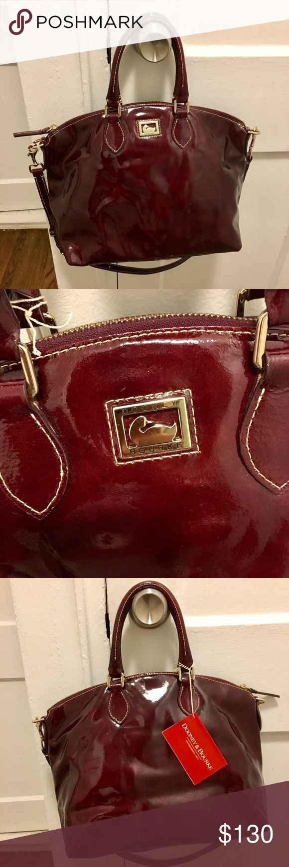 """Dooney and Bourke Patent Leather Satche NWT Dooney and Bourke Patent Leather Satchel in Bordeaux. Features: beautiful smooth patent wine colored leather, zip closure, silvertone hardware. Interior is fully lined, has 4 multipurpose pockets and a one key clip. Bag measures approx. 14"""" L x 10.5"""" H x 6"""" W. Handle drops to approx. 5"""" L. Adjustable strap measures approx. 31"""" L. Bag is new, unused. No dust bag or box. Comes with its registration card.  Has a few small scratches (highlighted in the…"""