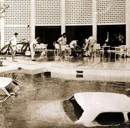 Cars in Travelodge Pool - Herald Sun