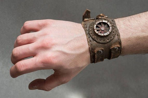 Rusted Dystopian Bracelet - Steampunk Post Apocalyptic Leather Cuff - Industrial Mens Leather Bracelet  Designer of the project is Viola Sychowska, founder of Wasted Couture collective. Leather work is made by Konrad Radziszewski, member of Wasted Couture collective!  This listing is for a made to order bracelet. Please Note: The bracelet pictured above is representative of the style. Individual bracelets will vary in appearance. This is post apocalyptic mens bracelet. It is a fusion of his…